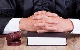 mark-hogan-mississauga-criminal-lawyer-toronto-hands-folded